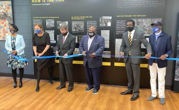 Mayor Joe Hogsett (third from left) anchors the ribbon-cutting team for the Still We Reach exhibit.